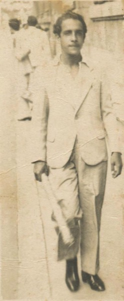 1940s - Strolling down the streets of Matanzas in his mid-20s carrying a rolled up canvas